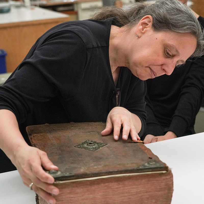 Conservator Erika Lindensmith talks about a King James Bible that will need preservation work  on May 3, 2019.