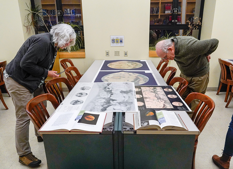 Visitors, including Philip O'Brien, right, get a look at maps of Mars in November 2018.