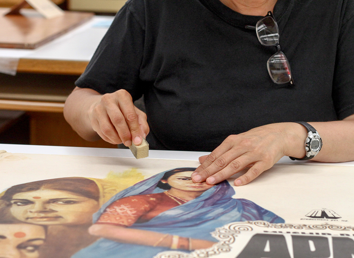 Movie posters are preserved in advance of a Bombay cinema exhibit at the Brown Gallery in Doe Library on Aug. 9, 2017. (Photo by Cade Johnson for the University Library)