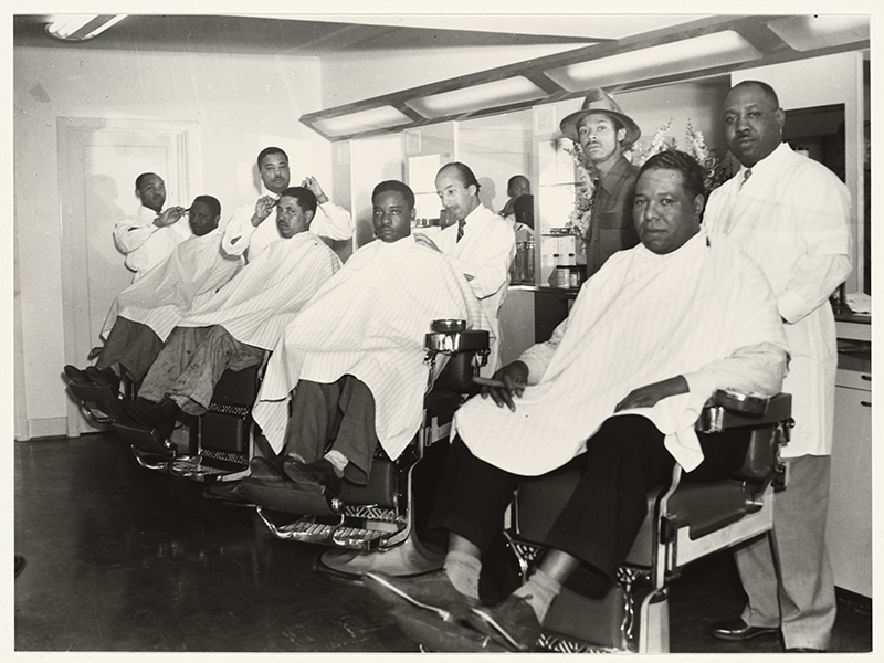 Men getting their hair cut in a barber shop