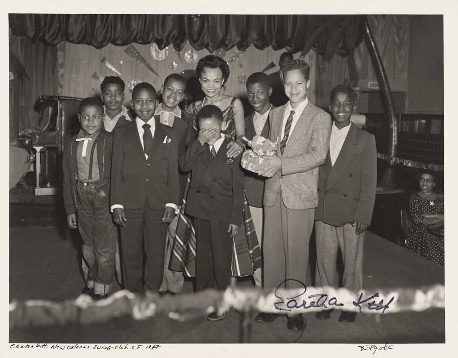 Eartha Kitt with a group of children.