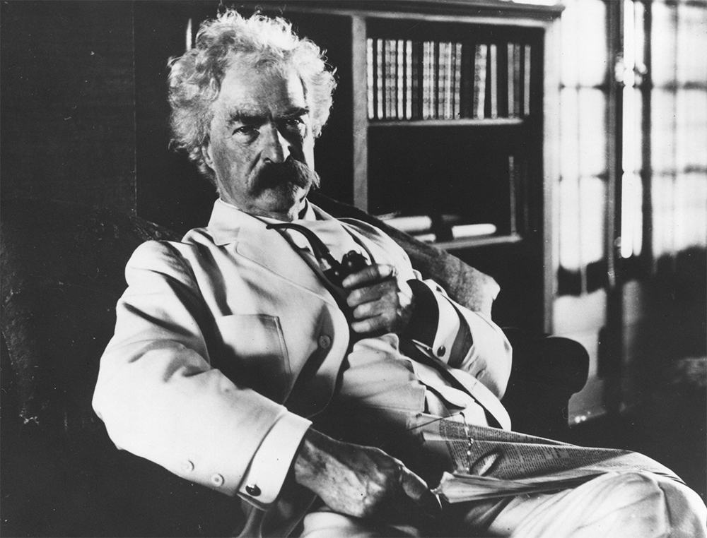 Mark Twain in October 1908 in the library of his newly built house in Redding, Conn.